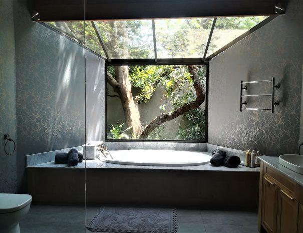 bathroom huge window ktp luxe bathtub